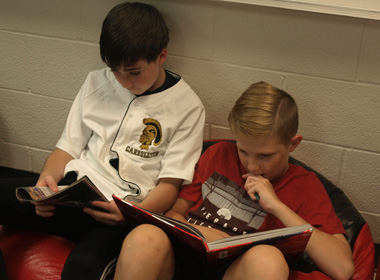 Two boys reading at CJHS